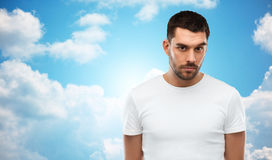 Young man portrait over sky and clouds background Stock Photo