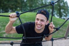 Young man portrait on the playground in the park. royalty free stock photos