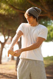 Young man portrait stretching after jogging Royalty Free Stock Photo