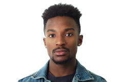Young man portrait studio white background face close-up twenty. Young man portrait twenty years old jeans jacket studio Stock Photography