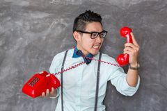 Young man portrait with telephone Royalty Free Stock Images