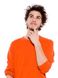 Young man portrait thinking pensive looking up Stock Photography