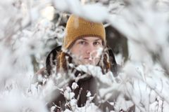 Young man portrait in winter snowy forest Royalty Free Stock Photo