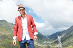 Young man poses in the mountains Royalty Free Stock Photography