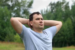 Young man poses outdoor at summer day Stock Photography