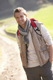 Young man poses in park Stock Photos