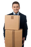 Young man posing with cardboard boxes Stock Image