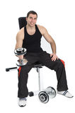 Young man posing with dumbbells Royalty Free Stock Photos