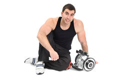 Young man posing with dumbbells Royalty Free Stock Image