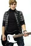 Young man posing with electric bass Royalty Free Stock Photo