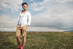 Young man posing in a field full of flowers Stock Photos