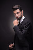 Young man posing handsome suit elegant, black background Stock Photos