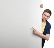 Young man posing next to a banner Royalty Free Stock Photography