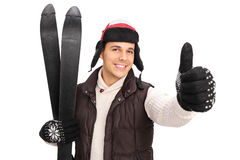 Young man posing with a pair of skis Royalty Free Stock Images