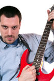 Young man posing with red electric guitar Royalty Free Stock Photo