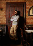Young man posing in a restaurant Stock Photography