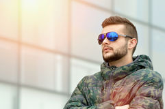 Young man posing. With a sunglasses on Royalty Free Stock Image