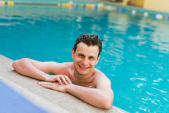 Young  man posing in the swimming pool Stock Images