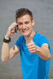 Young man posing thumbs up Royalty Free Stock Images