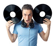 Young man posing to camera with two black vinyls Royalty Free Stock Photography