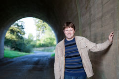 Young man posing in tunnel on sunny day Stock Photos