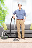 Young man posing with a vacuum cleaner Stock Images