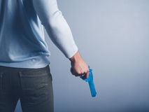 Young man posing with water pistol Stock Image