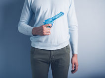 Young man posing with water pistol Royalty Free Stock Photos