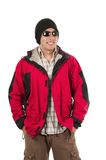 Young man posing wearing red winter coat Stock Image