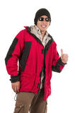 Young man posing wearing red winter coat Royalty Free Stock Photo