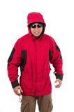 Young man posing wearing red winter coat Stock Photos