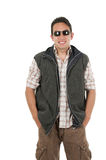Young man posing wearing sunglasses and vest Stock Image