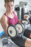 Young man posing with weights Royalty Free Stock Image