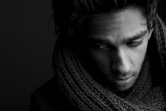 Young man posing with wool scarf Royalty Free Stock Photo