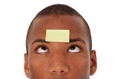 Young man with post it on his forehead Royalty Free Stock Photos