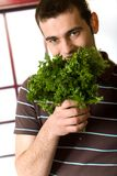 Young man with potherbs Stock Photos