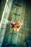 Young man practice parkour jump in the city Stock Photography