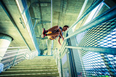 Young man practice parkour jump in the city Royalty Free Stock Photography