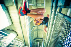 Young man practice parkour jump in the city Stock Images