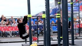 Young man practice street workout on open competition stock footage