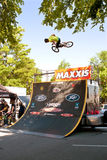 Young Man Practices Bicycle Jumps Before BMX Competition Royalty Free Stock Image