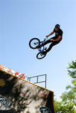 Young Man Practices Jump Tricks At BMX Competition Royalty Free Stock Image