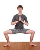 Young Man Practices Yoga Royalty Free Stock Image