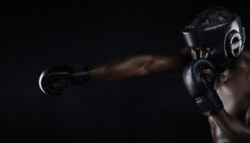 Young man practicing boxing Stock Photos