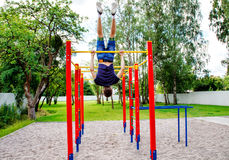 Young man is practicing on a horizontal bar Royalty Free Stock Photo