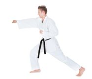 Young Man Practicing Karate Stock Photography