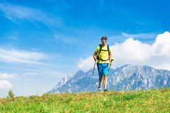 Young man practicing physical activity mountain and running with Stock Photos