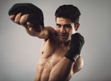 Young man practicing shadow boxing Stock Photography