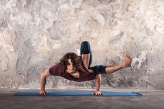 Young man practicing yoga. Man doing yoga exercises. Practicing yoga in a urban background Stock Photos
