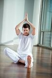 Young Man Practicing Yoga Stock Image